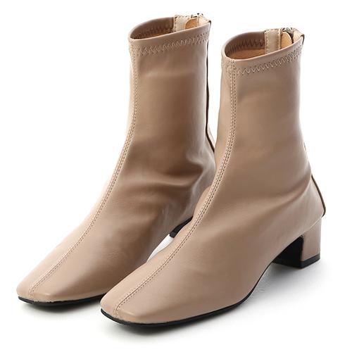 D+AF 潮模時尚.素面車線方頭低跟襪靴